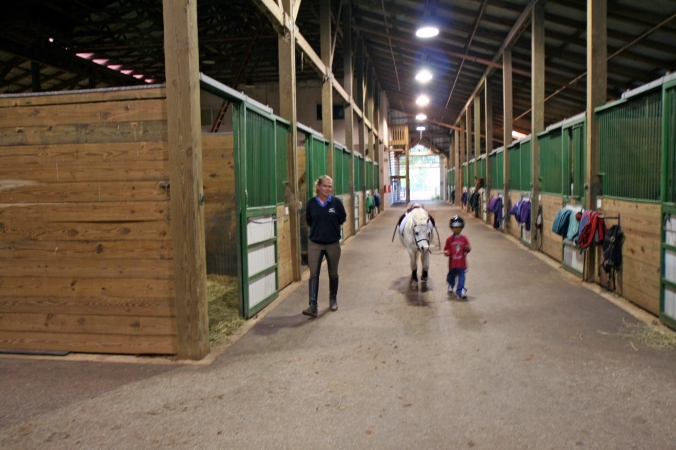 Looking down the barn aisle.