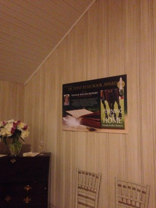 My face on the wall at the book award reception.